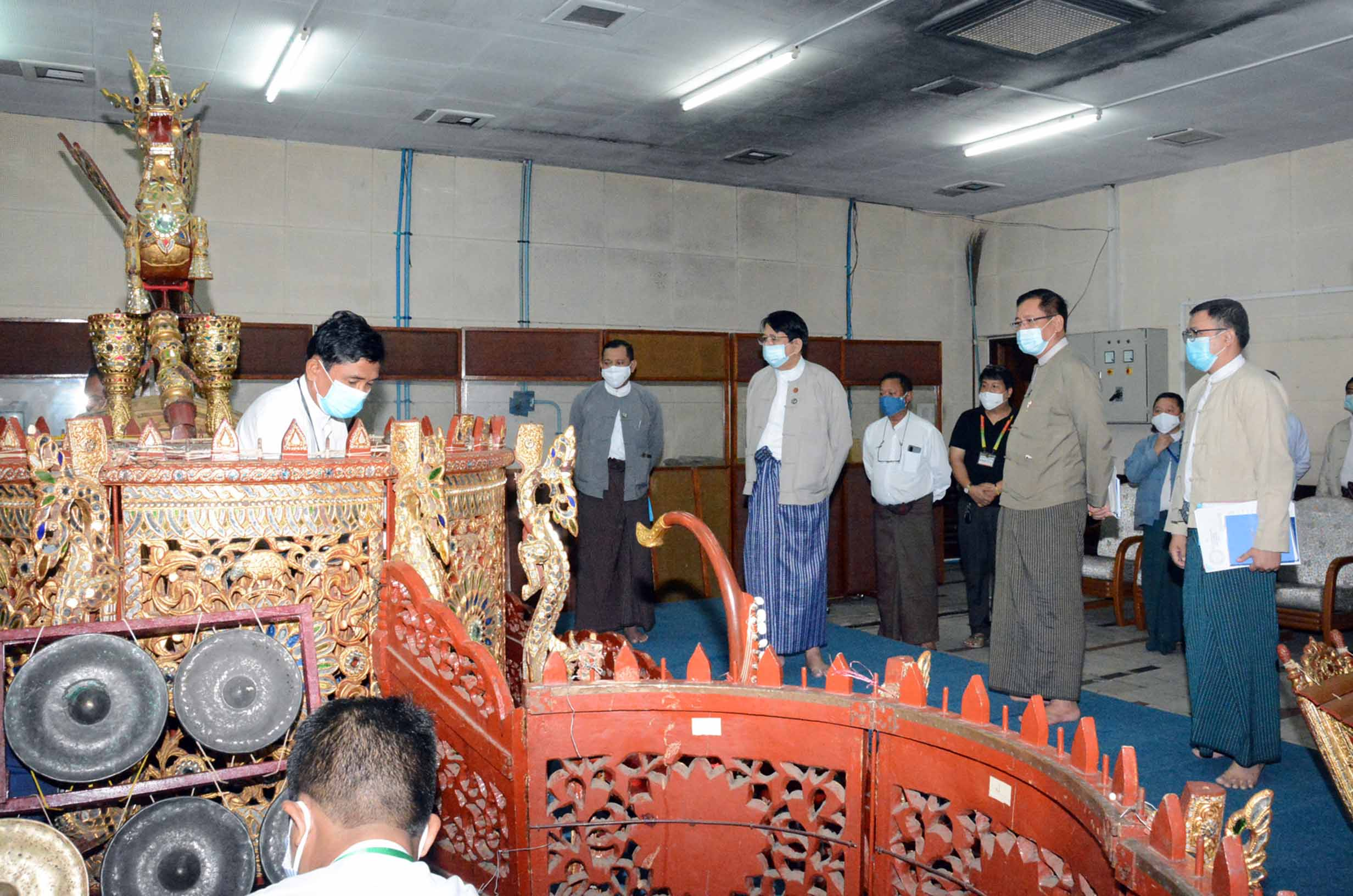 Union Minister Dr Pe Myint inspects the practising of the national symphony orchestra at the Radio Master Room of MRTV in Yangon on 18 July 2020. Photo: MNA