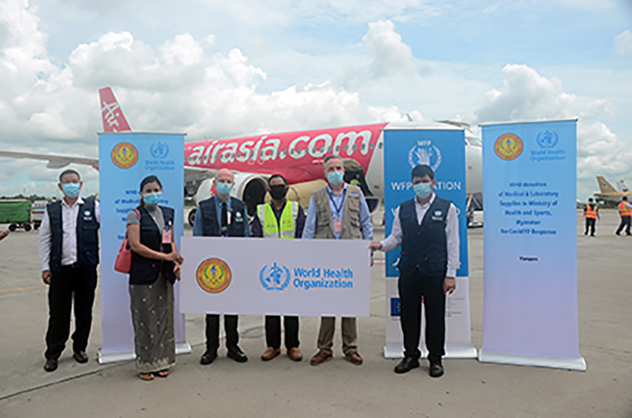 WHO's medical experts and Myanmar's officials pose for a group photo at the Yangon International Airport on 19 July 2020.Photo: Pe Zaw
