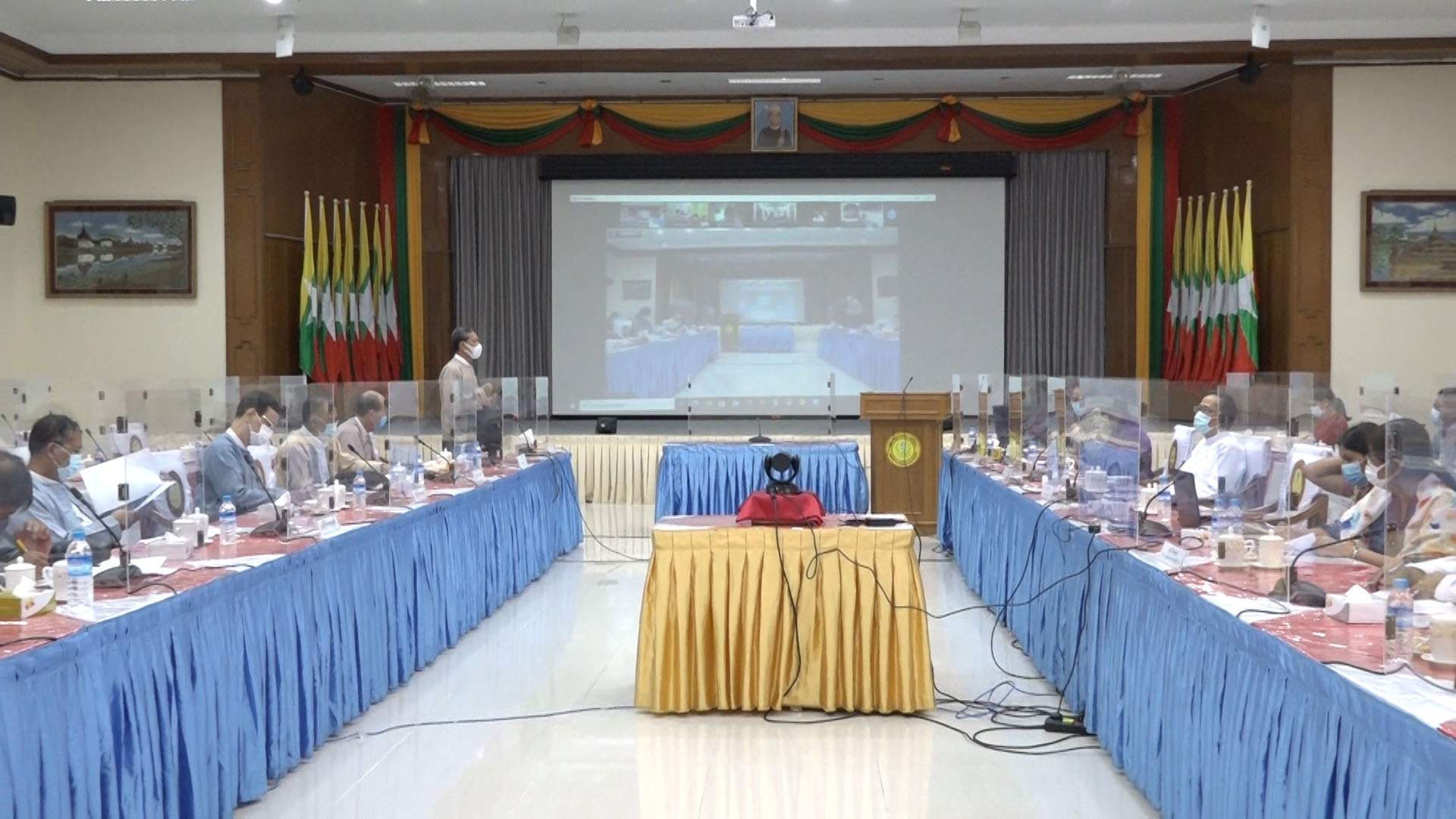 Union Minister Dr Myo Thein Gyi (left top) speaks during the meeting for reopening schemes of high schools. PHOTO: MNA