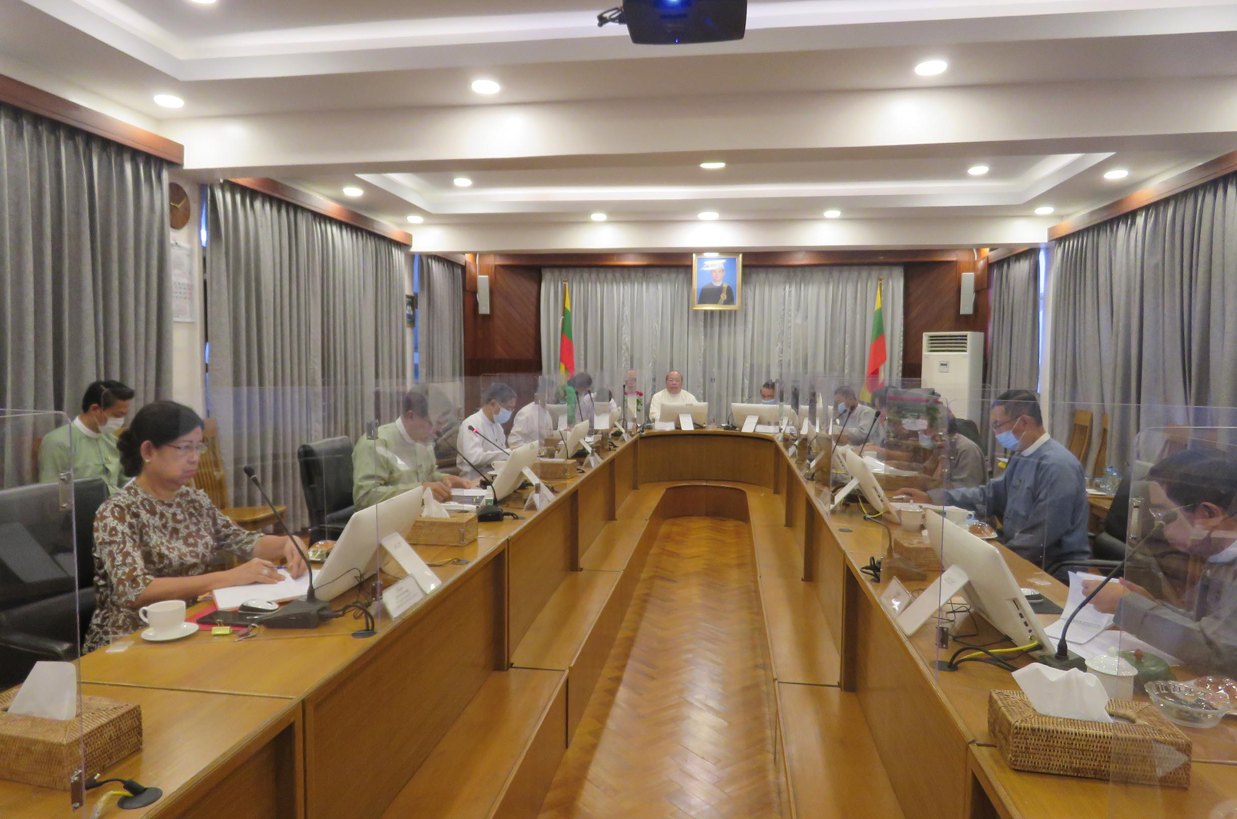 Union Minister U Thaung Tun chairs regular meeting of MIC on 14 August.Photo: MNA