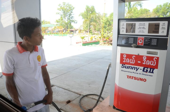 A man refilling the vehicle with fuel at a filling station in Yangon.Photo: Phoe Khwar