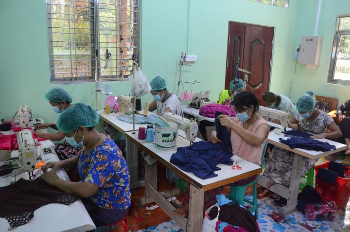 Textile workers sewing on the production line at a garment factory in Yangon.Photo: Phoe Khwar