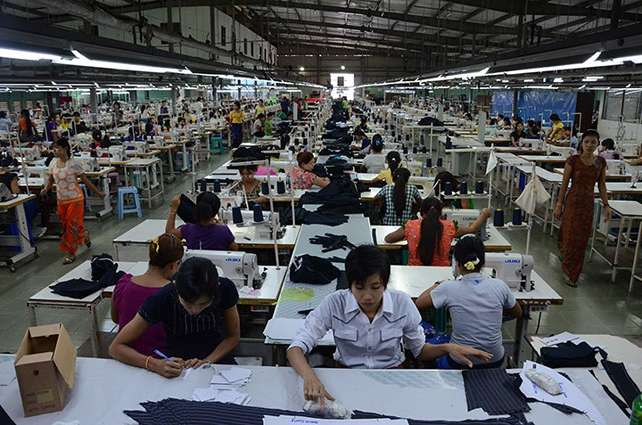 Workers seen on a production line at a garment factory in Hlinethaya on the outskirts of Yangon.Photo: Phoe Khwar (GNLM)