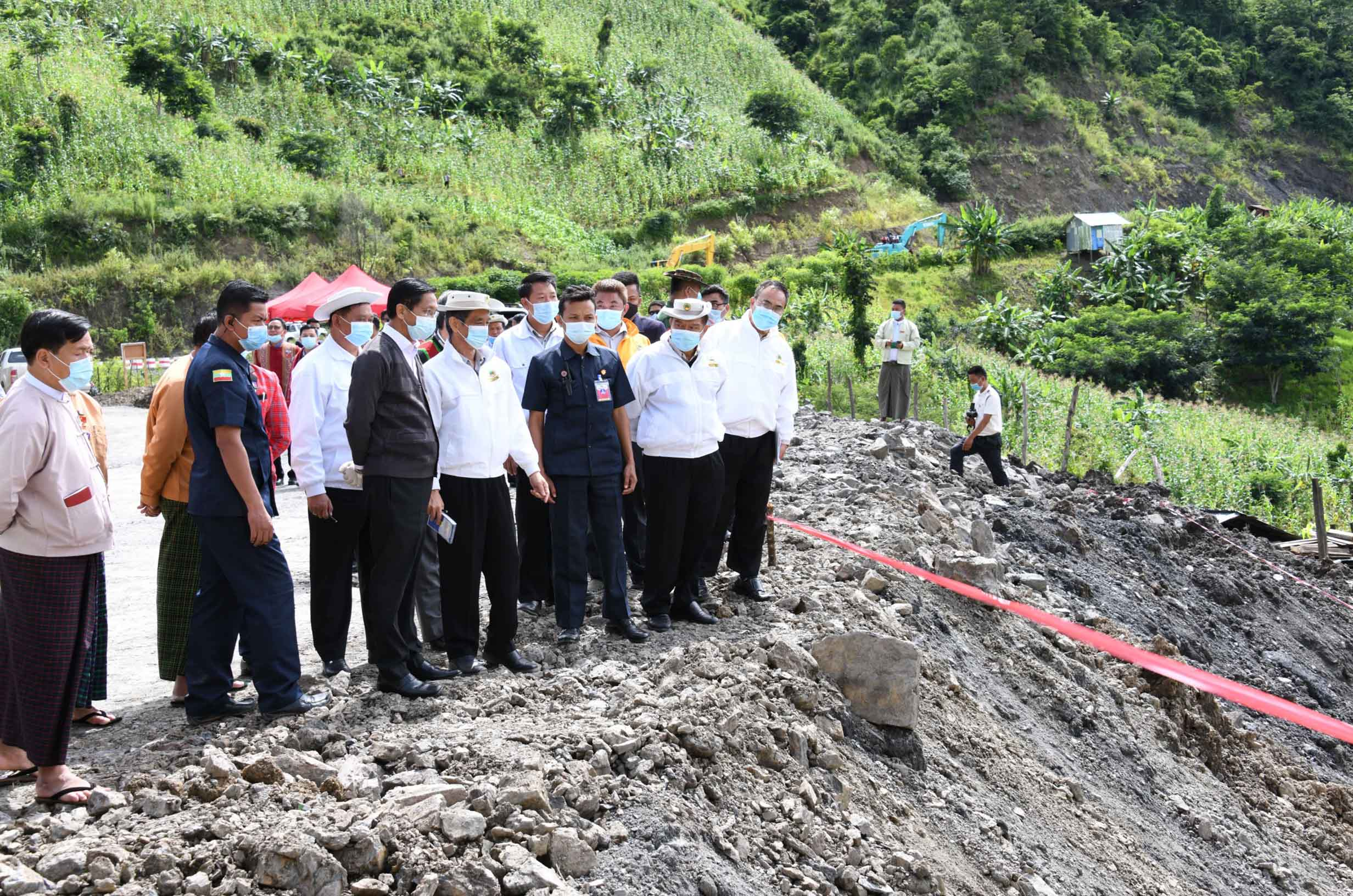 Vice President U Henry Van Thio and entourage inspect the landslide on the ring road of Thantlang Town in Chin State on 15 August 2020.Photo: MNA