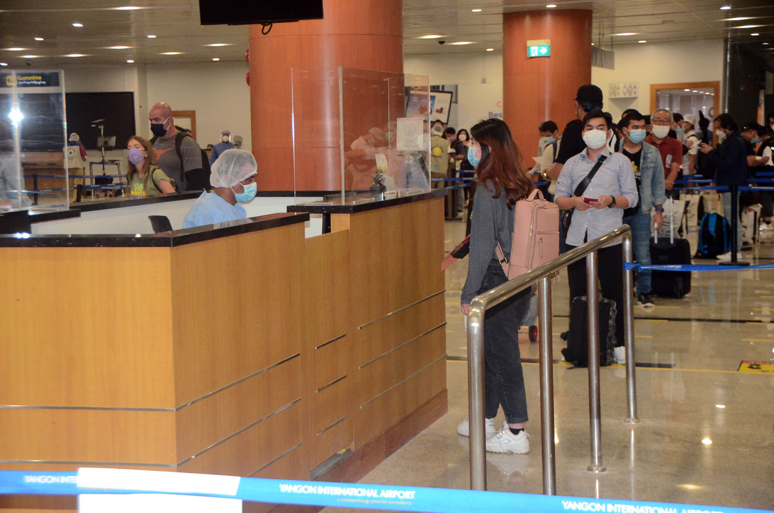 Myanmar citizens returned from foreign countries queue for immigration service at the Yangon International Airport on 11 August 2020. Photo: MNA
