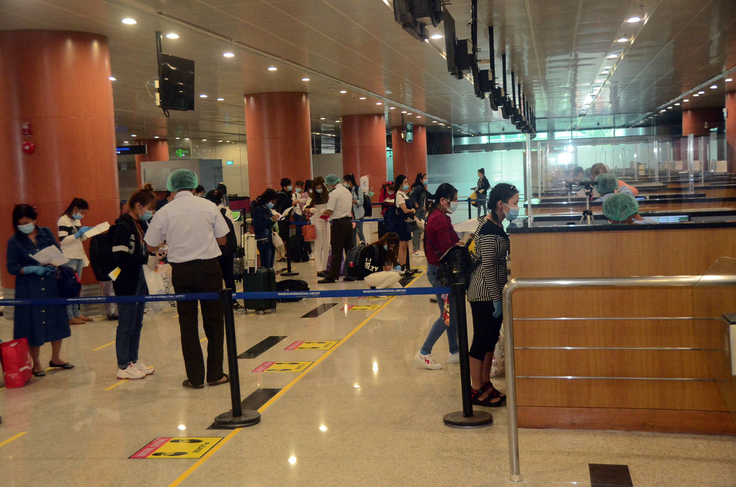 Myanmar citizens returned from Malaysia queue for immigration process at the Yangon International Airport on 15 August 2020.Photo: MNA