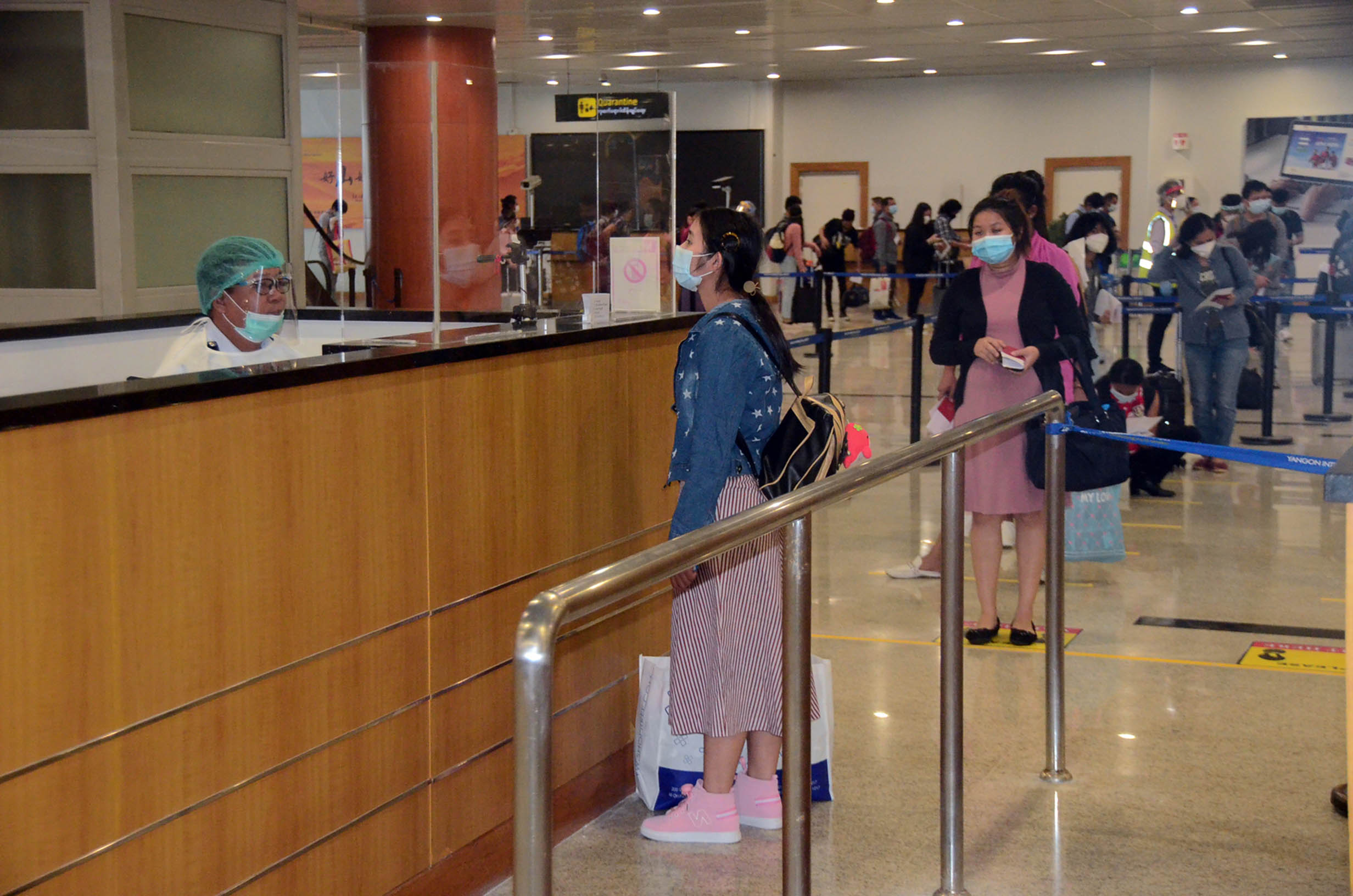 Myanmar citizens returned from Singapore queue for immigration process at the Yangon International Airport on 16 August 2020.Photo: MNA