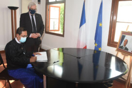 MoFA official signs book of condolences for deceased former French President