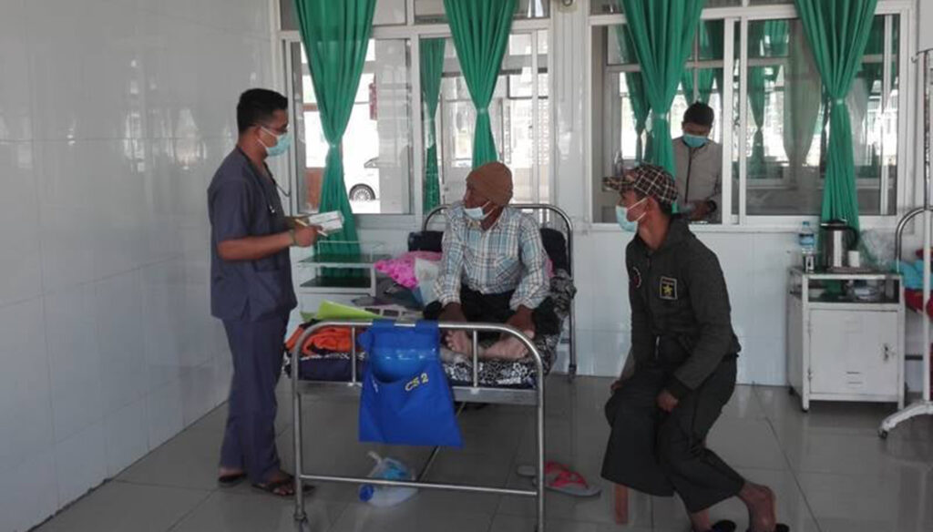 One of the local inpatients is seen receiving medical treatment at the military hospital.