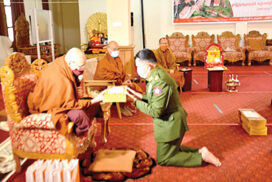 Military personnel pay homage, donate offertories  to Buddhist monks