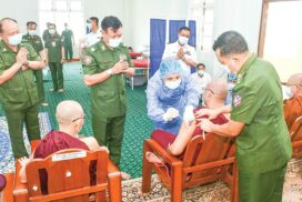 Venerable Sayadaws, government staff, locals receive COVID-19 vaccines