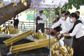 State Administration Council Chairman Commander-in-Chief of Defence Services Senior General Min Aung Hlaing, wife Daw Kyu Kyu Hla, pour water at banyan trees on fullmoon day of Kason
